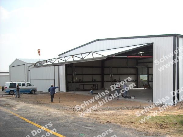 Ranch Road Builders install Aircraft Hangar Hydraulic Door