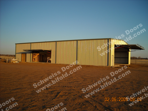 Aircraft Hangar with Hydraulic Door in Sidewall and Endwall Fully Open